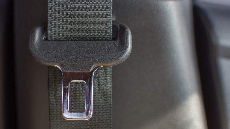 Car interior detail with car seat belt or safety belt in car
